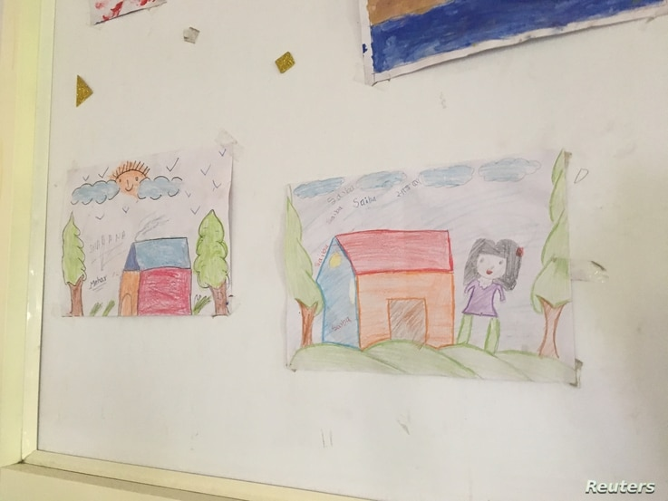 Drawings by children on the wall of a shelter for homeless women in New Delhi, which has among the most homeless people in India, July 4, 2018.