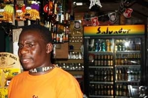 """Emton Kalimanjira behind the bar at Kaapsche Hoop, South Africa...He enjoys meeting lots of """"strange, but wonderful"""" people from all over the world here"""