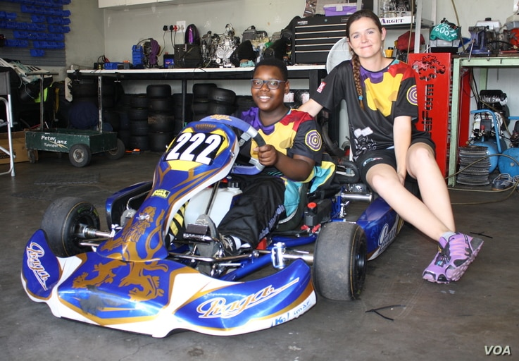 Lanz with one of her learner drivers, 13 year old Nqaba Ntombela.