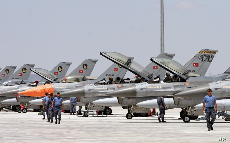 FILE - Dozens of Turkish F-16 jets prepare to take off during Anatolian Eagle exercise at 3rd Main Jet Air Base near the central Anatolian city of Konya.