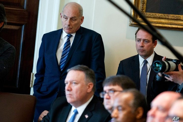 White House Chief of Staff John Kelly listens as President Donald Trump speaks during a cabinet meeting at the White House in Washington, April 9, 2018.
