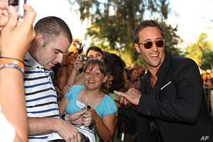 """Star Alex O'Loughlin (right) celebrates the second season premiere of """"Hawaii Five-0"""" with fans in Honolulu on Sept. 10."""