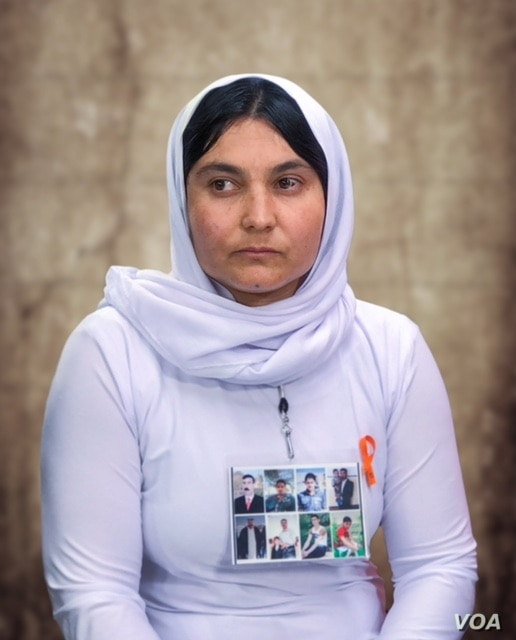 Shireen Jardo talks about her enslavement by the Islamic State during an interview with Voice of America. She wears a poster with pictures of her three brothers and five other members of her extended family still missing in IS territory. Washington, ...