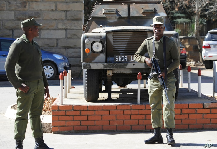 Army personnel man outside the military headquarters in Maseru, Lesotho, Aug. 31, 2014.
