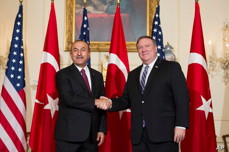 Secretary of State Mike Pompeo, right, meets with Turkish Foreign Minister Mevlut Cavusoglu at the State Department in Washington, June 4, 2018.