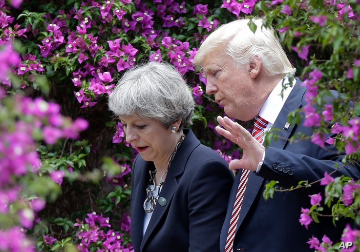 U.S. President Donald Trump talks with British Prime Minister Theresa May in Taormina, Italy.
