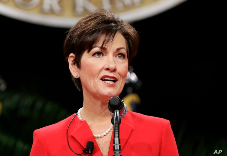 FILE - In this Jan. 16, 2015, photo, Iowa Lt. Gov. Kim Reynolds delivers remarks after taking the oath of office during inauguration ceremonies in Des Moines.