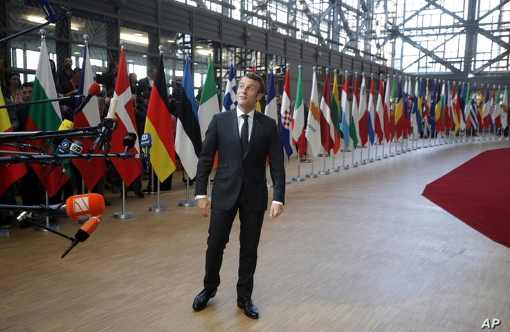 French President Emmanuel Macron speaks with the media as he arrives for an EU summit in Brussels, March 21, 2019.