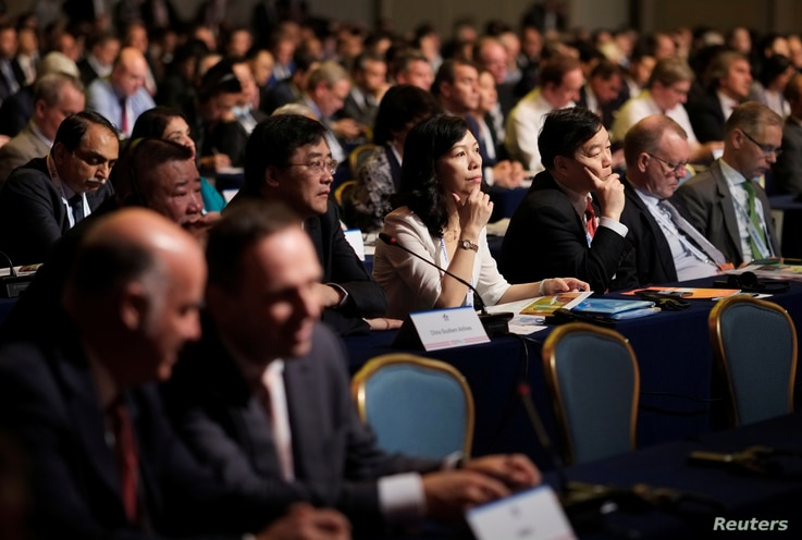 People attend a meeting of the International Air Transport Association (IATA) in Cancun, Mexico, June 5, 2017.