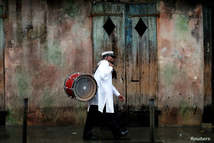 A musician walks in the French Quarter as Hurricane Nate approaches the U.S. Gulf Coast in New Orleans, Oct. 7, 2017.
