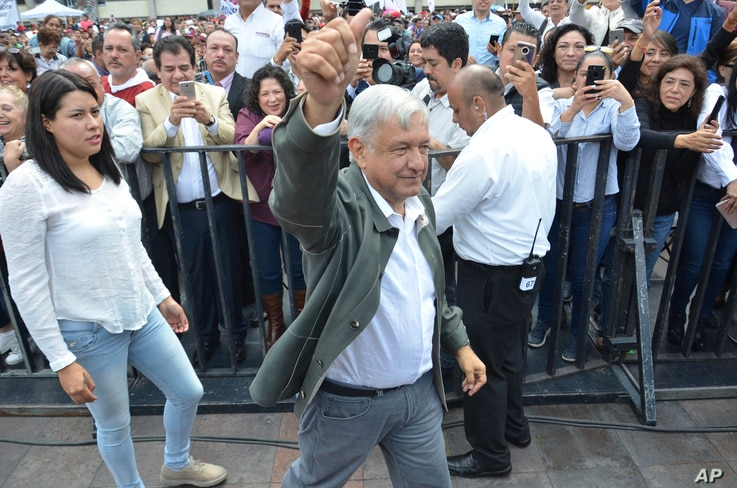 Mexico's President-elect Andres Manuel Lopez Obrador arrives to a rally commemorating the 50th anniversary of a bloody reprisal against students, at the Tlatelolco Plaza in Mexico City, Saturday, Sept. 29, 2018. Lopez Obrador vowed Saturday to never ...
