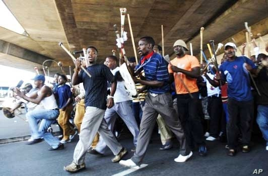 IFP supporters wielding traditional Zulu weapons march through Durban… The NFP accuses the IFP of intimidation ahead of South Africa's municipal polls on May 18