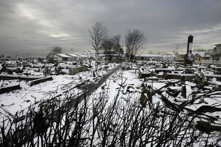 The fire-scorched landscape of Breezy Point  after a Nor'easter snow, November 8, 2012 in New York.  The beachfront neighborhood was devastated during Superstorm Sandy when a fire pushed by the raging winds destroyed many homes.