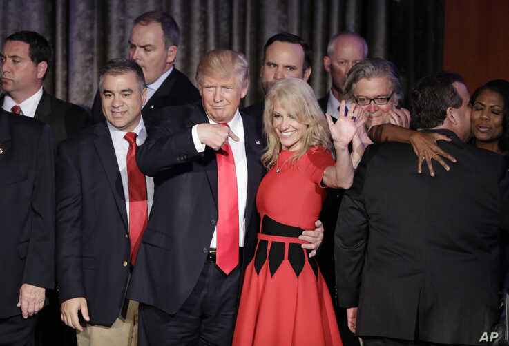 FILE - Then President-elect Donald Trump and campaign manager Kellyanne Conway celebrate during an election night rally.