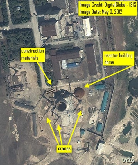 Satellite imagery from May 3, 2012 showing construction materials and support equipment waiting to be placed on  the reactor building.