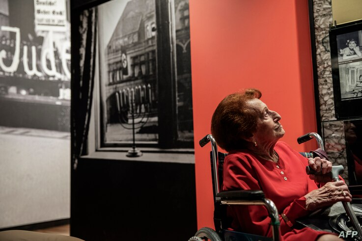 Holocaust survivor Veronica Phillips looks at her family portraits and memorabilia during the official opening of the Johannesburg Holocaust & Genocide Center and its permanent exhibition in Johannesburg, South Africa, March 14, 2019.