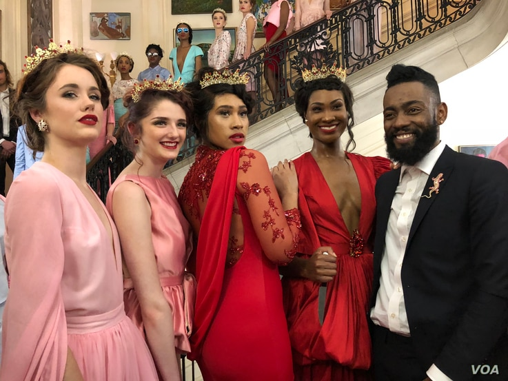 """Haitian designer Prajje Oscar, right, with his models wearing gowns from his """"Ezili"""" collection, which were hand-sewn by Haitian artisan women. Prajje's collection was the show stopper at the Haitian Embassy """"Diplomacy By Design"""" event, Feb. 23, 2018..."""