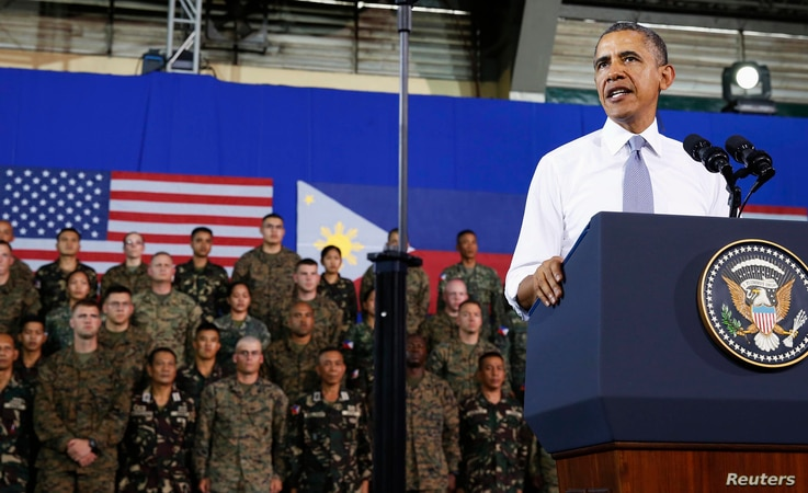U.S. President Barack Obama speaks to military troops at the Fort Bonifacio Gymnasium in Manila, April 29, 2014.  Obama said a new military pact signed with the Philippines on Monday granting a larger presence for U.S. forces would bolster the Southe...