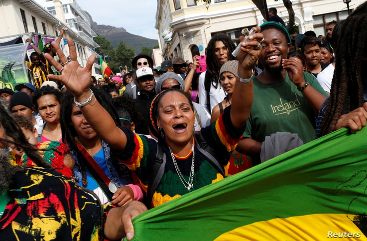 FILE - A protester carries a marijuana pipe during a march calling for the legalization of cannabis in Cape Town, South Africa, May 7, 2016.