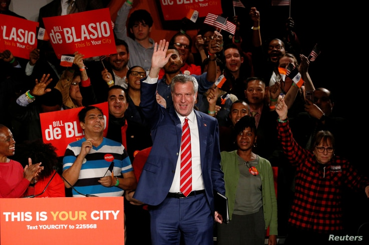 New York Mayor Bill de Blasio is greeted by supporters after his re-election in New York City, Nov. 7, 2017.