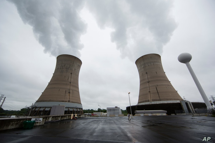 File - A May 22, 2017, photo shows cooling towers at the Three Mile Island nuclear power plant in Middletown, Pennsylvania.
