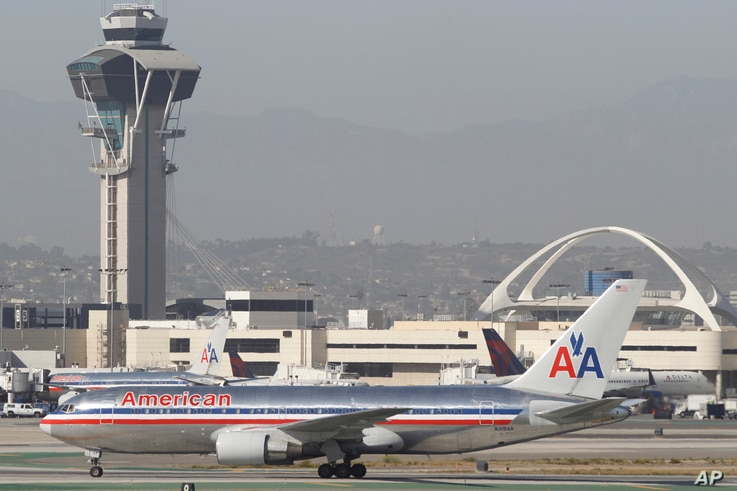 FILE - An American Airlines Boeing 767 waits to take off at Los Angeles International Airport.