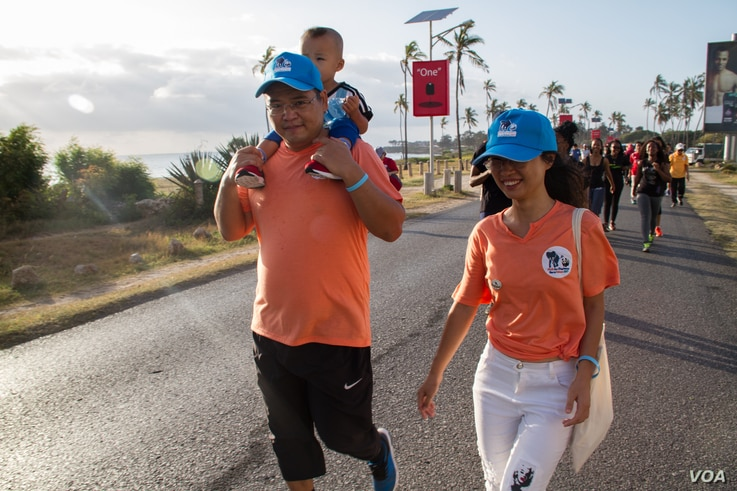 Jimmy Liguo with his wife Lisa and son Jimmy Jr. attend the 'Walk for Elephants' march in Dar es Salaam.
