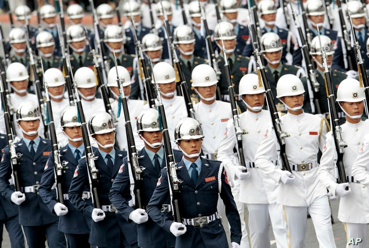 Taiwan military honor guard march during the National Day celebrations in Taipei, Taiwan, Oct. 10, 2016.