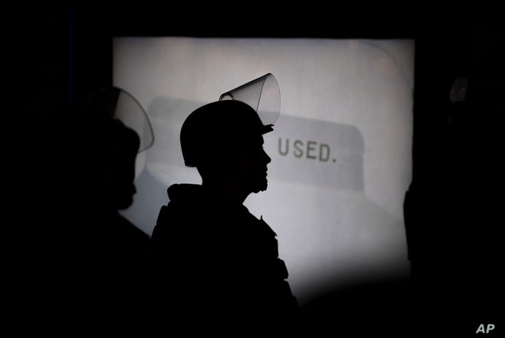 A police officer monitors the scene during a speech by Ben Shapiro on the campus of the University of California n Berkeley, Calif., Sept. 14, 2017.