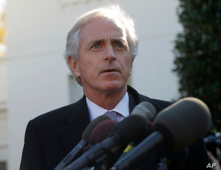Sen. Bob Corker, ranking Republican on the Senate Foreign Relations Committee, speaks to members of the media following a meeting with President Barack Obama, outside the West Wing of the White House in Washington, Nov. 19, 2013.