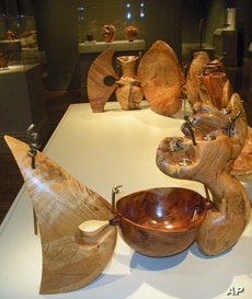 Curator Nicolas Bell says about two to three dozen exotic woods, including African Black wood, pink ivory and ebony, are represented in the exhibit.