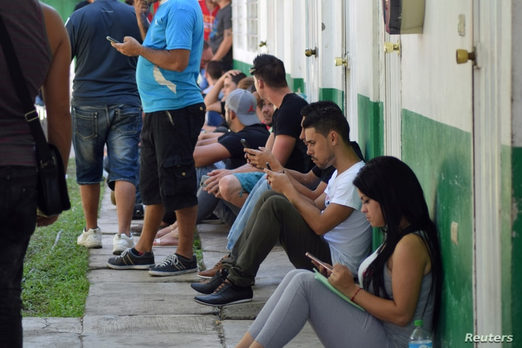 Cubans gather at the migration office while waiting for their safe passage to cross Mexico after Washington repealed a measure granting automatic residency to virtually every Cuban who arrived in the United States, in Tapachula, Mexico, Jan. 17, 2017...