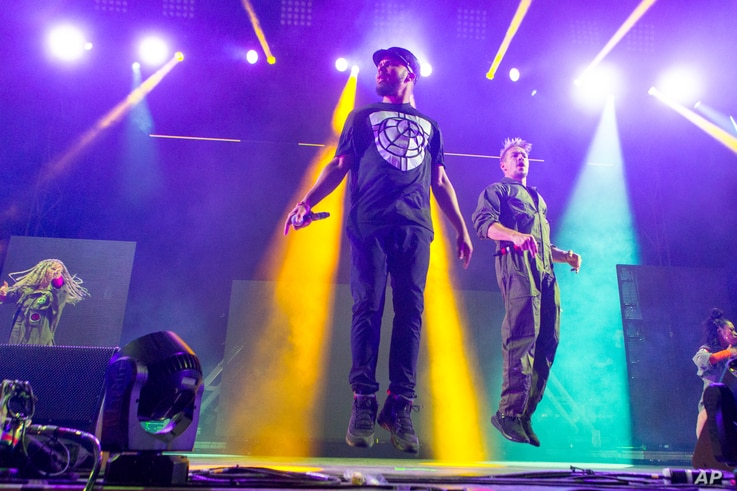 Walshy Fire, left, and Diplo of Major Lazer perform during the Life is Beautiful festival on September 25, 2015 in Las Vegas.