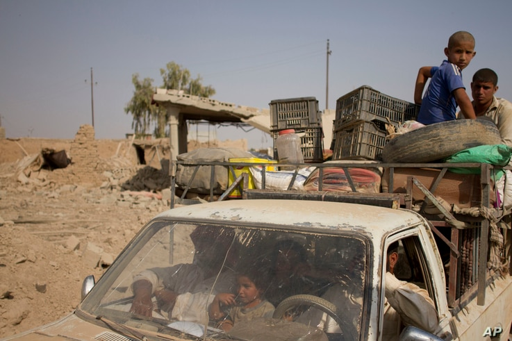 Civilians flee villages outside Mosul a day after Iraqi Kurdish forces launched an operation east of the Islamic State-held city in Iraq, Aug. 15, 2016. The Kurdish forces known as the Peshmerga say they have retaken 12 villages in the operation in a...