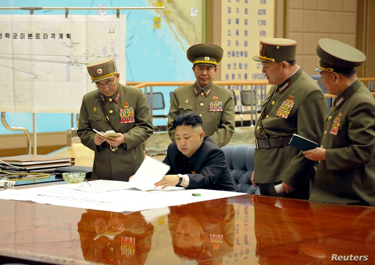 North Korean leader Kim Jong Un (C) presides over an urgent operation meeting on the Korean People's Army Strategic Rocket Force's performance of duty for firepower strike, at the Supreme Command in Pyongyang, March 29, 2013.