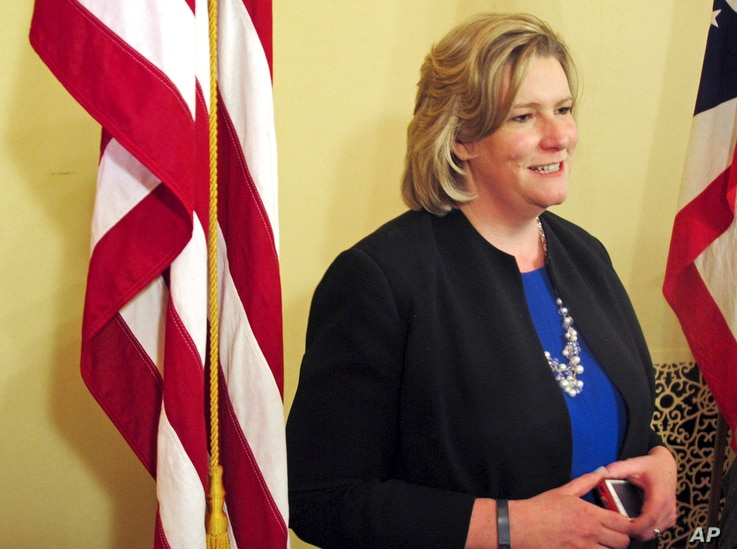 FILE – In this April 1, 2015, photo, Dayton, Ohio, Mayor Nan Whaley addresses reporters during a news conference in Columbus, Ohio.