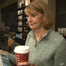 Sally Shafor gets a cup of coffee at a Starbucks in Alexandria, Virginia.
