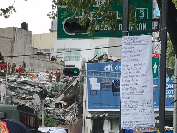 Work continues at the site of a collapsed building in Mexico City, Mexico, Sept. 22, 2017. Mexican officials are promising to keep up the search for survivors as rescue operations stretch into a fourth day after Tuesday's major earthquake that devast...