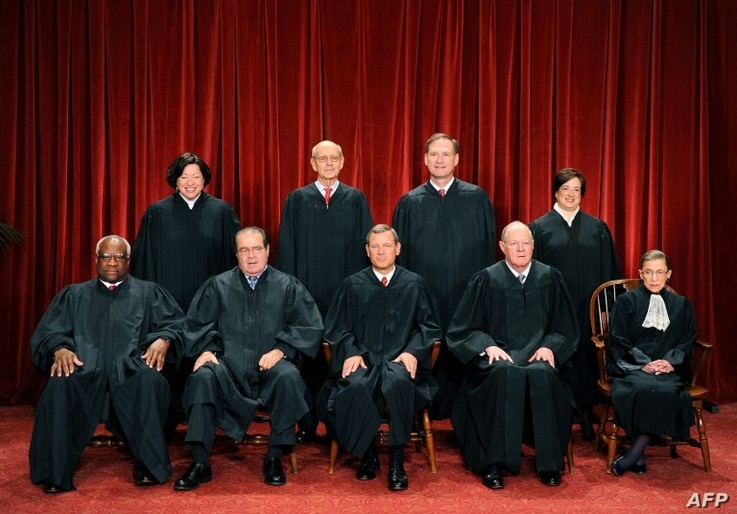 The Justices of the US Supreme Court sit for their official photograph on October 8, 2010 at the Supreme Court in Washington, DC, October 8, 2010.