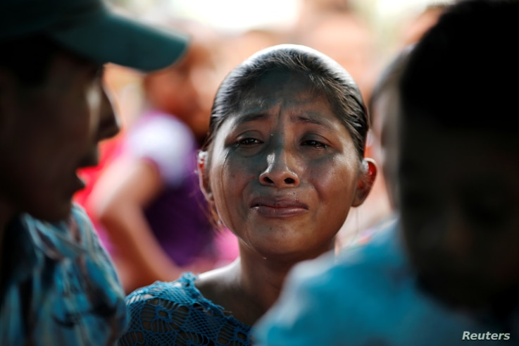 Claudia Maquin, mother of Jakelin Caal, 7, reacts during her daughter's funeral at her home village of San Antonio Secortez, in Guatemala, Dec. 25, 2018.