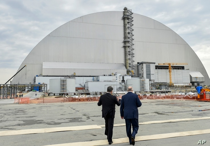 Ukrainian President Petro Poroshenko, left, and Belarusian President Alexander Lukashenko visit the Chernobyl nuclear power plant in Chernobyl, Ukraine, marking the 31st anniversary of the Chernobyl nuclear disaster, April 26, 2017.