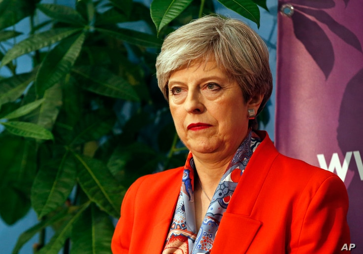 Britain's Prime Minister Theresa May listens as the declaration at her constituency is made for in the general election in Maidenhead, England, June 9, 2017. British Prime Minister Theresa May's gamble in calling an early election appeared Friday to ...