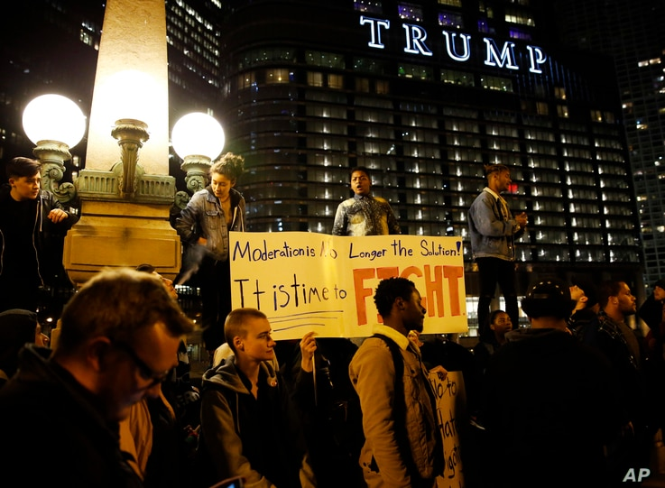 Protesters gather in downtown Chicago as they protest the election of President-elect Donald Trump, Nov. 10, 2016.