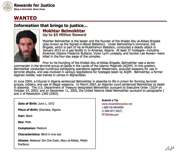 FILE - A wanted poster from the website of the U.S. State Department's Rewards For Justice program shows a mugshot of terrorist Mokhtar Belmokhtar.
