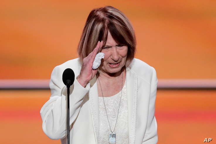 Pat Smith, mother of Benghazi victim Sean Smith, salutes after speaking during the opening day of the Republican National Convention in Cleveland, July 18, 2016.