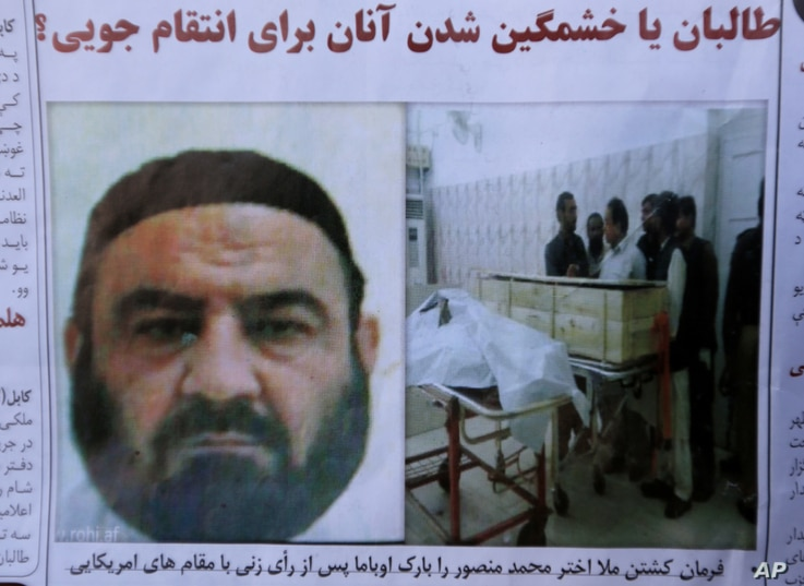FILE - An Afghan newspaper headlines pictures of the former leader of the Afghan Taliban, Mullah Akhtar Mansoor, who was killed in a U.S. drone strike on May 21, 2016.