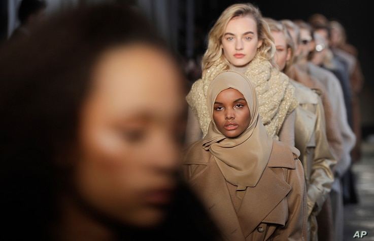 Somali-American model Halima Aden wears a creation part of the Max Mara women's Fall-Winter 2017-18 collection, that was presented in Milan, Italy, Feb. 23, 2017.