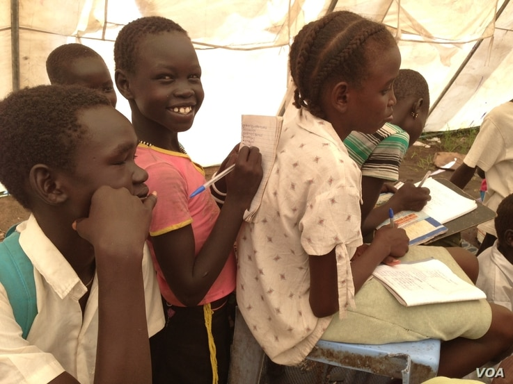 Displaced South Sudanese children attend class inside a tent set up by UNICEF in Mingkaman, in Lakes State. The schooling of the vast majority of children displaced by months of fighting in South Sudan has been interrupted.