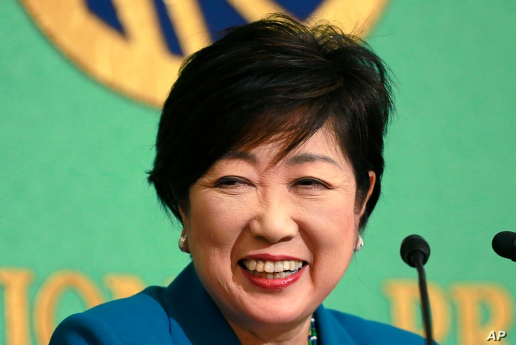 Tokyo Gov. Yuriko Koike smiles during a press conference at the Japan National Press Club in Tokyo, Sept. 28, 2017.