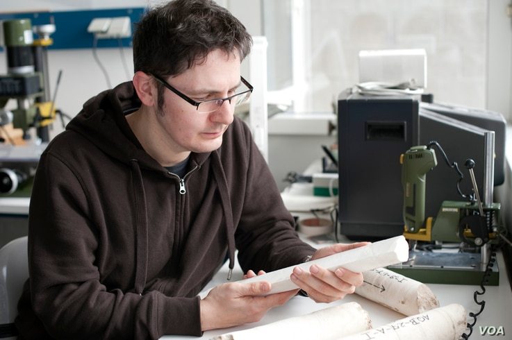 Paleo-climatologist Thomas Felis in his laboratory at the Center for Marine Environmental Sciences University of Bremen Germany inspects core samples from the Great Barrier Reef dating from the peak of the last ice age 20,000 years ago. (Credit: Volk...